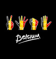 hands on Belgium flag background lettering vector image vector image