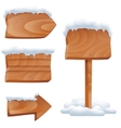 Wooden signs in snow set vector image vector image