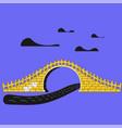 yellow brick arch bridge over river