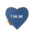 blue jeans heart on denim background vector image