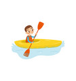 little boy engaged in kayaking cheerful kid vector image vector image