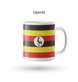 Uganda flag souvenir mug on white background vector image vector image