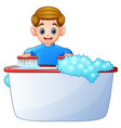 happy boy cleaning bathtub on a white background vector image vector image