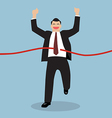 Businessman running at the finish line vector image