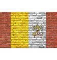 Flag of Vatican City on brick wall vector image