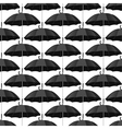 Seamless pattern with black umbrellas vector image