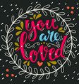 You are loved Hand lettering in wreath with vector image vector image