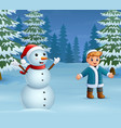 happy boy playing with a snowman in winter vector image vector image