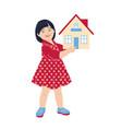 little girl holding house model vector image vector image