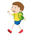 Little boy with schoolbag walking vector image vector image
