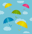 umbrella colorful set with clouds vector image vector image
