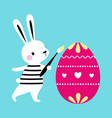 cute little bunny painting and decorating egg vector image vector image