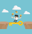 businessman cross the cliff with key to success vector image vector image