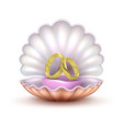 realistic golden wedding rings in seashell vector image