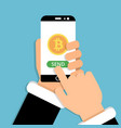 hand holding smartphone with bitcoin symbol on vector image vector image