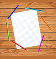notebook sheet surrounded with colored pencils on vector image