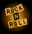 rock and roll inscription on paper on a brownish vector image