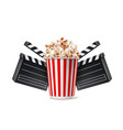 cinema poster popcorn cup and clapper board vector image vector image