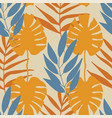 yellow and blue tropical leaves seamless vector image vector image