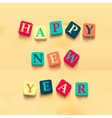 words happy new year with colorful blocks vector image vector image