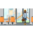 Woman standing inside public transport vector image