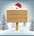 santa claus hat on wood board on winter background vector image