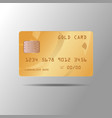 a realistic gold credit card isolated on gray vector image