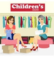 woman chooses baby clothes in childrens store vector image
