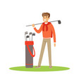 golf player in a blue pullover standing with a bag vector image