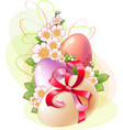 flowers and colored eggs for easter vector image vector image