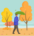 young man walks in autumn rainy nature city park vector image vector image