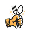 fork and spoon in hand symbol cooking cookery vector image vector image