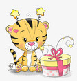 greeting card cute tiger with gift vector image vector image