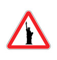 attention america statue of liberty on red vector image vector image