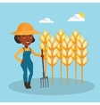 Farmer with pitchfork at wheat field vector image vector image