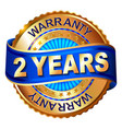 2 year warranty golden label with ribbon vector image