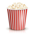 a full red-and-white striped bucket of popcorn vector image vector image