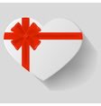 Heart-shaped gift with red bow vector image vector image