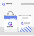 company shopping bags design with q logo vector image vector image