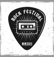 guitar pick with audiotape and text rock festival vector image vector image