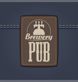 leather label for brewery or pub on denim backdrop vector image vector image