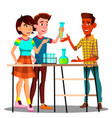 group of students standing at table with flasks vector image