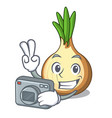 photographer cartoon ripe yellow onion for cooking vector image