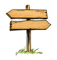 old wooden double direction sign vector image