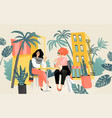two lovely girls sitting at a table in a summer vector image