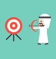 arab business man drawing bow to shooting target