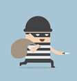 Thief cartoon holding knife in his hand and carryi vector image vector image