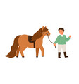 smiling little boy walking with pony holding vector image vector image