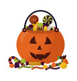 basket halloween pumpkin with candies isolated vector image