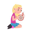 cute girl sitting on floor and embroidering vector image